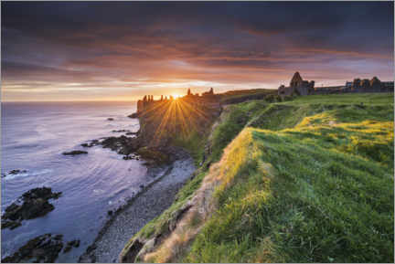 Premium poster Castle ruins by the sea in Ireland at sunrise