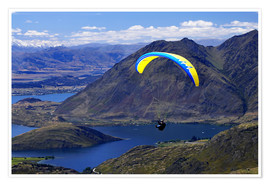Premium poster Paraglider over mountain landscape