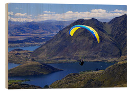 Wood print  Paraglider over mountain landscape - David Wall