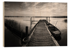 Frank Herrmann - Wooden pier on lake with fishing boat - black and white