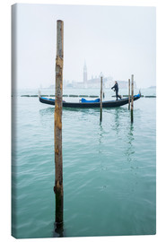 Canvas print  Gondolier with his gondola on the water in Venice in fog - Jan Christopher Becke
