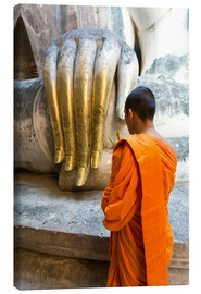 Canvas print  Monk praying in front of Buddha Hand - Matteo Colombo