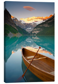 Canvas print  Canoe on Lake Louise at sunrise - Miles Ertman