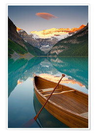 Premium poster Canoe on Lake Louise at sunrise