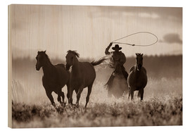 Wood print  Cowboy of the horses catches - Richard Wear
