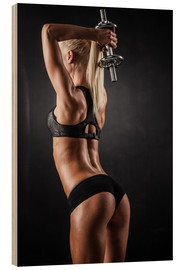 Wood print  Athletic woman with dumbbells