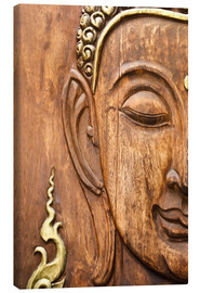 Wood face of the Buddha