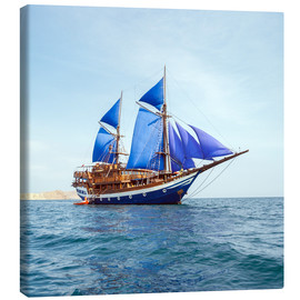 Canvas  Vintage Wooden Ship with Blue Sails