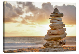 Canvas print  Stone pyramid in the evening sun, Cairn