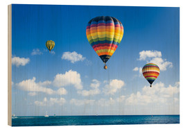 Wood print  Colorful hot air balloons on the blue sea