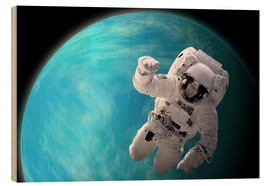 Wood print  Artist's concept of an astronaut floating in outer space by a water covered planet. - Marc Ward