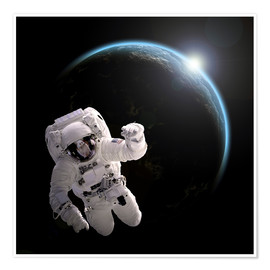 Premium poster Astronaut floating in space as the sun rises on to Earth-like planet.