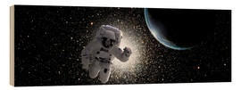 Wood print  Astronaut floating in deep space with an Earth-like planet in background. - Marc Ward