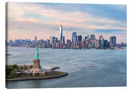 Canvas print  Aerial view of Statue of Liberty and World Trade Center at sunset, New York city, USA - Matteo Colombo