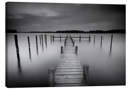Canvas  Old wooden pier in the still waters - Filtergrafia
