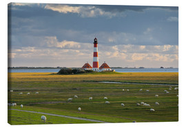 Canvas print  Lighthouse Westerhever, cumulus clouds, salt meadow, watts, sheep - Rainer Mirau