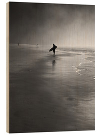 Wood print  A lone surfer on his way into the sea. - Alex Saberi