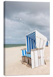 Canvas print  Seagull and beach chair on Sylt