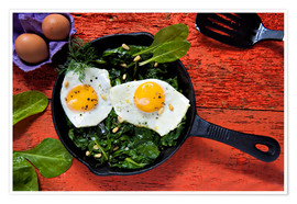 Premium poster Breakfast pan eggs on spinach