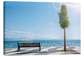 Canvas print  Shore of Lake Garda with Alps on the horizon
