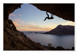Premium poster Climber in a cave at sunset