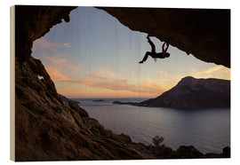Wood print  Climber in a cave at sunset
