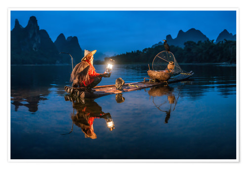Premium poster Chinese cormorant fisherman in front of karst landscape in Guilin, China
